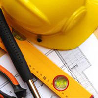 Stock image of hard hat and building plans